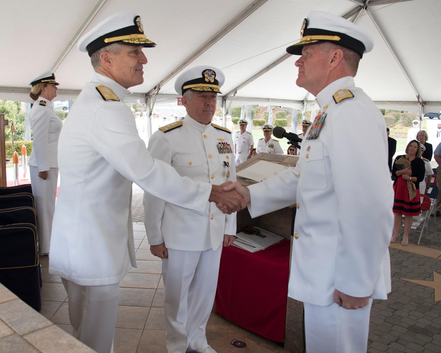 Adm. Samuel J. Paparo, commander, U.S. Pacific Fleet, congratulates Vice Adm. Stephen T. Koehler upon assuming command of U.S. 3rd Fleet during a change of command ceremony on Naval Base Point Loma, June 3.