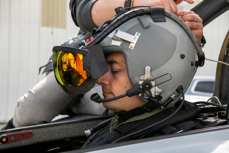 U.S. Air Force Maj. Scott Thorup, Air Combat Command Training Support Squadron Detachment 14 commander, prepares for takeoff as Rina Shkrabova, Red 6 director of hardware design, connects the augmented reality headset to the Berkut in Santa Monica, Calif., April 13, 2021.