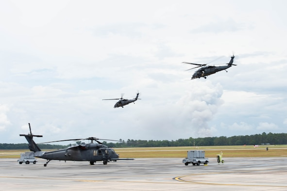 A photo of helicopters flying.