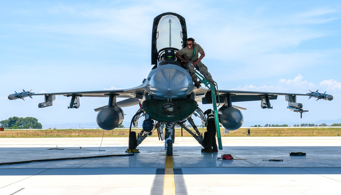 U.S. Air Force Staff Sgt. Jordan Mooring, 555th Aircraft Maintenance Unit F-16 Fighting Falcon crew chief, prepares to perform recovery operations on a U.S. Air Force F-16 Fighting Falcon assigned to the 555th Fighter Squadron at Amendola Air Base, Italy, June 4, 2021. Six U.S. Air Force F-16C aircraft will be participating  in Falcon Strike 21 (FS21), an exercise involving service members from the U.S., Israel, Italy and the United Kingdom to integrate fourth and fifth generation fighter capabilities in a large force employment event. The exercise is a multilateral military training exercise conducting air operations in a contested multinational force environment. (U.S. Air Force photo by Airman 1st Class Brooke Moeder)