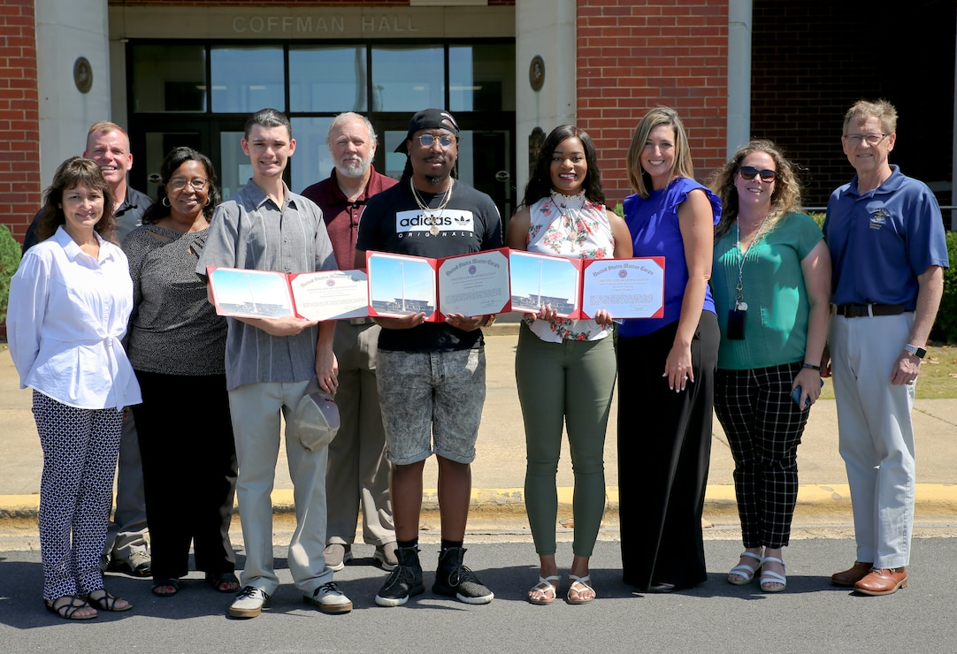 The first group of Marine Corps Logistics Base Albany interns from Albany Technical College each received a Certificate of Appreciation for their service. There were seven interns total serving over a 12-week period.   William Sandefur, Lorenzo Thomas and Tanesha Tumblin received their certificates from Leonard Housley, executive director, MCLB Albany, during a ceremony on base, June 1. Thomas and Tumblin were hired for full-time employment by the contract company working with the base's Communications and Information Systems Division. The group performed well and were beneficial to the divisions they served.  Not pictured are Rateque Waters, Kateria Taylor, Tora Williams and Oscar Conley.