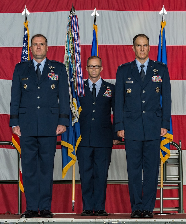 Maj. Gen. Thad Bibb, left, 18th Air Force commander; Chief Master Sgt. Timothy Bayes, 436th Airlift Wing command chief, and Col. Matthew Husemann, incoming 436th AW commander, stand at attention during the 436th AW Assumption of Command ceremony on Dover Air Force Base, Delaware, June 4, 2021. Husemann assumed command in a ceremony attended by friends, family, Team Dover members, local civic leaders and distinguished visitors. (U.S. Air Force photo by Roland Balik)