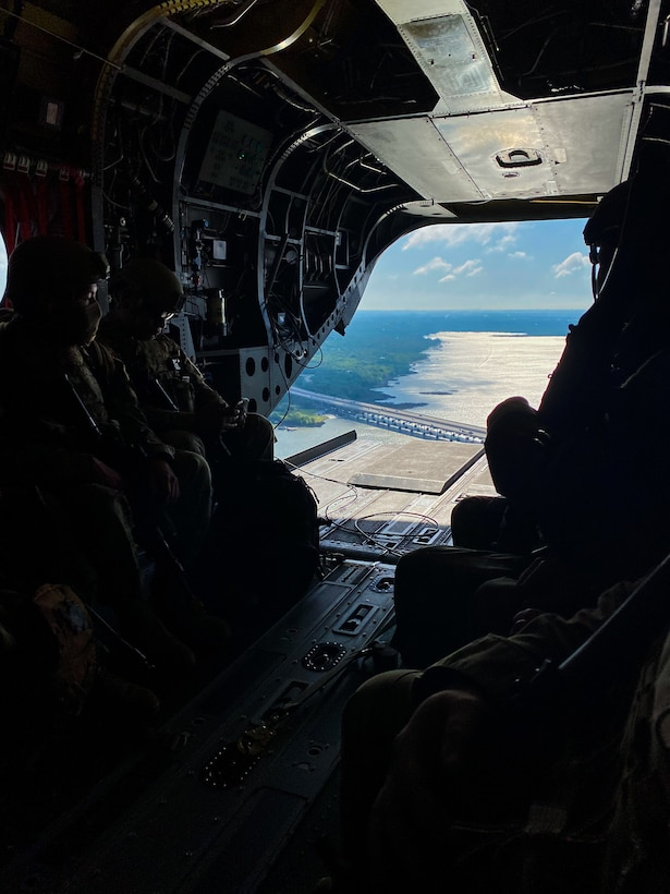 Airman surveys area of operations on C-130 ramp