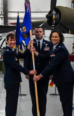 Col. Tracy Allen, left, 436th Medical Group commander, passes the guidon to Lt. Col. Kristen Nichols during the 436th Operational Medical Readiness Squadron change of command ceremony on Dover Air Force Base, Delaware, May 27, 2021. The ceremony saw Lt. Col. Andrew Rees relinquish command to Nichols. (U.S. Air Force photo by Airman 1st Class Stephani Barge)