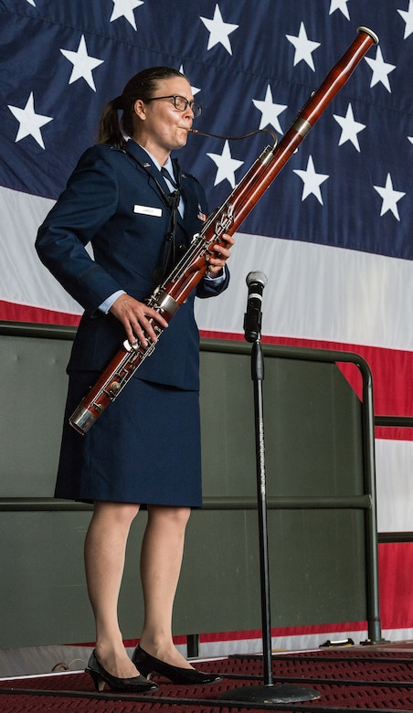 First Lt. Laura Lanier, 436th Aerial Port Squadron section commander, plays Ruffles and Flourishes during the 436th Airlift Wing Assumption of Command ceremony on Dover Air Force Base, Delaware, June 4, 2021. Col. Matthew Husemann assumed command of the Eagle Wing in a ceremony officiated by 18th Air Force commander Maj. Gen. Thad Bibb. (U.S. Air Force photo by Roland Balik)