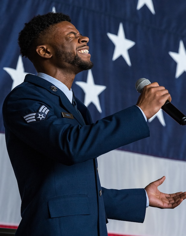 Senior Airman Joshua Varner, 436th Aerial Port Squadron fleet service specialist, sings the national anthem during the 436th Airlift Wing Assumption of Command ceremony on Dover Air Force Base, Delaware, June 4, 2021. Col. Matthew Husemann assumed command of the Eagle Wing in a ceremony officiated by 18th Air Force commander Maj. Gen. Thad Bibb. (U.S. Air Force photo by Roland Balik)