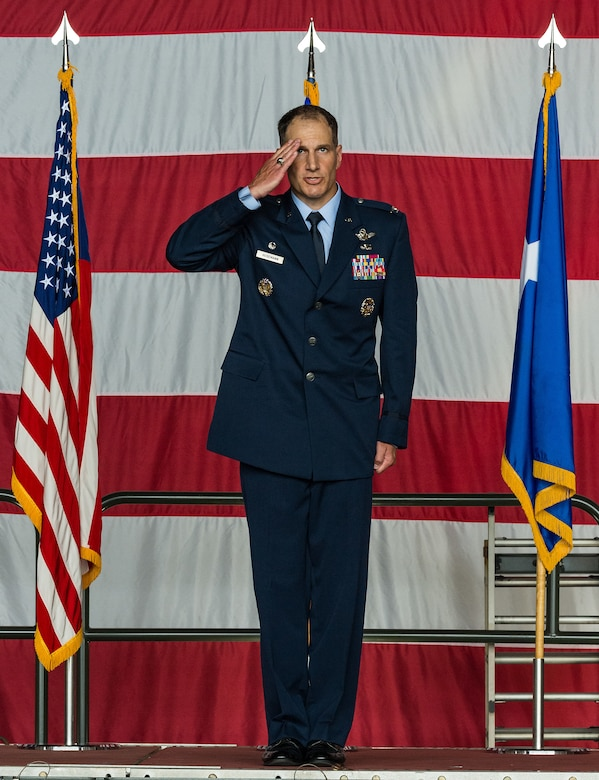 Col. Matthew Husemann, 436th Airlift Wing commander, receives his first salute from a formation of Team Dover Airmen during the 436th AW Assumption of Command ceremony on Dover Air Force Base, Delaware, June 4, 2021. Husemann takes command following an assignment as the 86th Airlift Wing vice commander at Ramstein Air Base, Germany. (U.S. Air Force photo by Roland Balik)