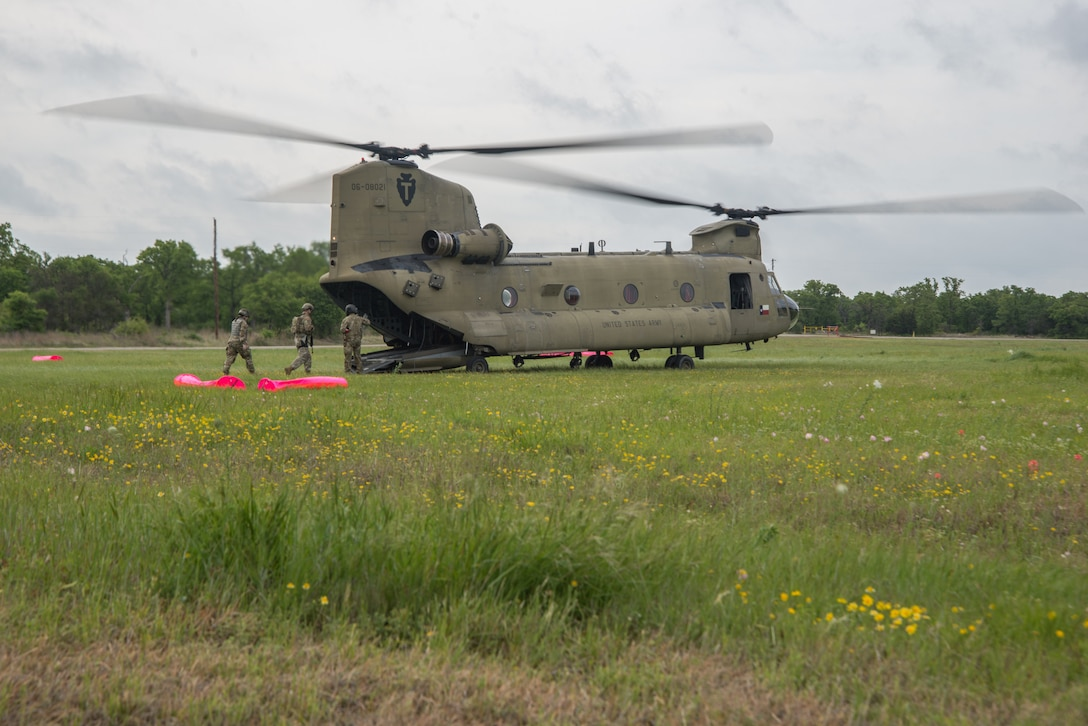Airmen load on to a Chinook