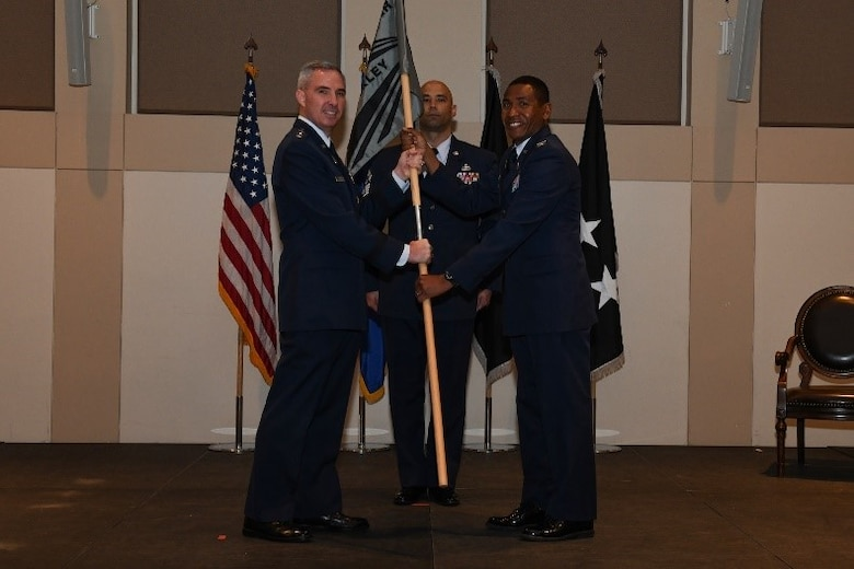 Col. Marcus Jackson, right, incoming Buckley Garrison commander, receives the guidon from Lt. Gen. Stephen Whiting, left, Space Operations Command commander, during the Buckley Garrison Assumption of Command Ceremony at Buckley Space Force Base, Colo., June 4, 2021. The passing of the guidon is a symbolic tradition accomplished in front of the unit so all can witness the new commander assuming the position. (U.S. Space Force photo by Senior Airman Danielle McBride)