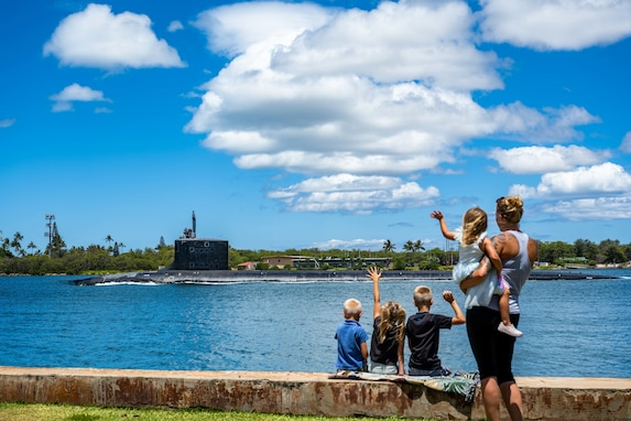 JOINT BASE PEARL HARBOR-HICKAM (June 3, 2021) -- Family members wave as the Virginia-class fast-attack submarine USS Missouri (SSN 780) departs Joint Base Pearl Harbor-Hickam for Exercise Agile Dagger 2021 (AD21). AD21 is a training exercise, with one-third of the Pacific Submarine Force getting underway, to assess warfighting readiness and build capacity for the joint force. (U.S. Navy photo by Mass Communication Specialist 1st Class Michael B. Zingaro/Released)