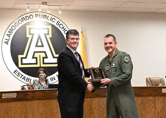 Ryan Sherwood, left, Alamogordo Public School Board vice president, presents Col. Bryan Callahan, 49th Wing vice commander, with the New Mexico School Board Association Student Achievement Award, May 19, 2021, in Alamogordo, New Mexico. Throughout his tenure, Callahan worked alongside school board members to bring improvements to both Holloman Air Force Base and the Alamogordo community. (U.S. Air Force photo by Shelley Bailey)