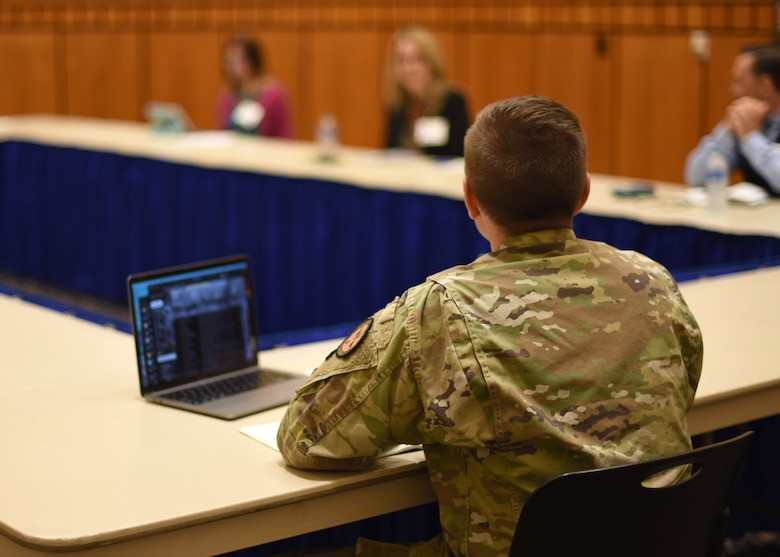 Members of the Goodfellow Air Force Community Partnership Program conduct a discussion at the quarterly update meeting at Angelo State University's Houston Harte University Center in San Angelo, Texas, June 3, 2021. The discussion emphasized strategies for improving Center for Teaching & Learning Excellence foundations. (U.S. Air Force photo by Senior Airman Abbey Rieves)