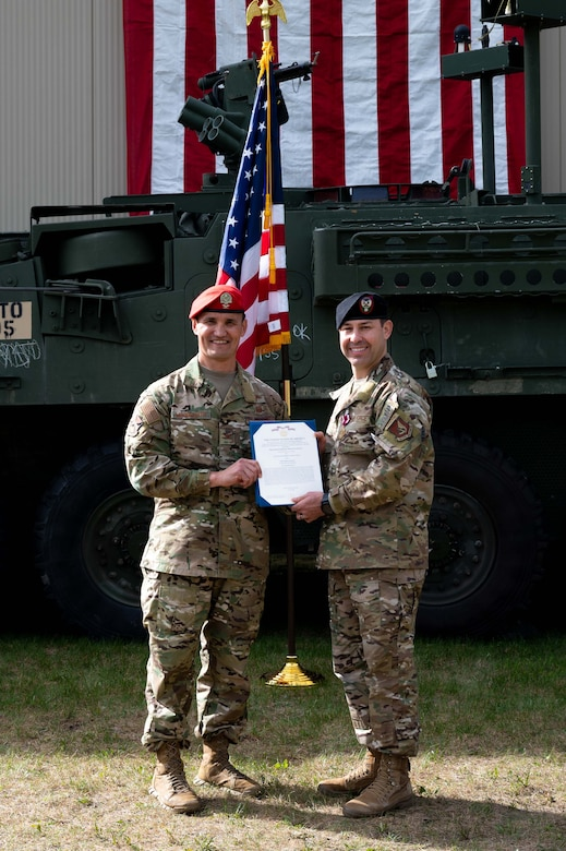 U.S. Air Force Col. Travis Woodworth (left), the 1st Air Support Operations Group commander, and Lt. Col. Ulysses Linares, former 3rd Air Support Operations  Squadron (ASOS) commander, pose for a photo during a change of command ceremony at Fort Wainwright, Alaska, June 4, 2021.
