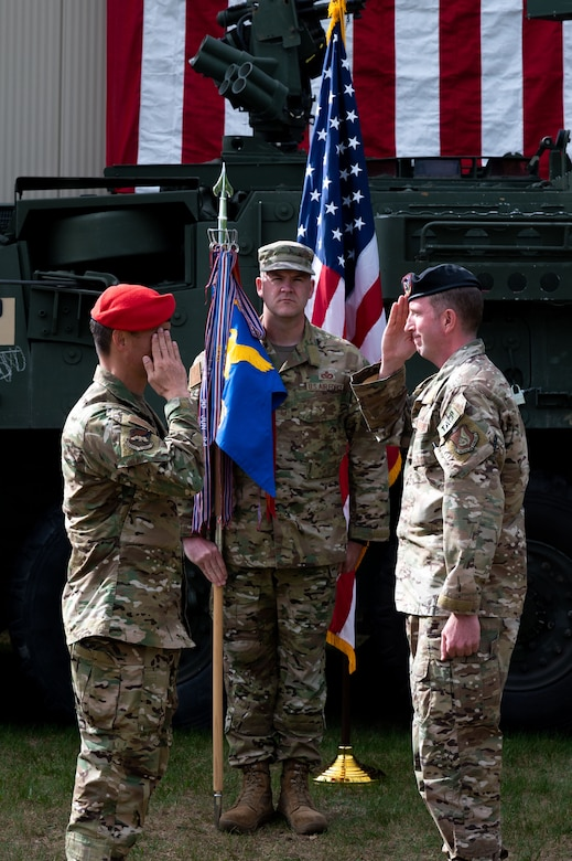 U.S. Air Force Lt. Col. Kyle Mattie (right), the 3rd Air Support Operations Squadron (ASOS) commander, renders a salute to Col. Travis Woodworth, the 1st Air Operations Group commander, during a change of command ceremony at Fort Wainwright, Alaska, June 4, 2021.