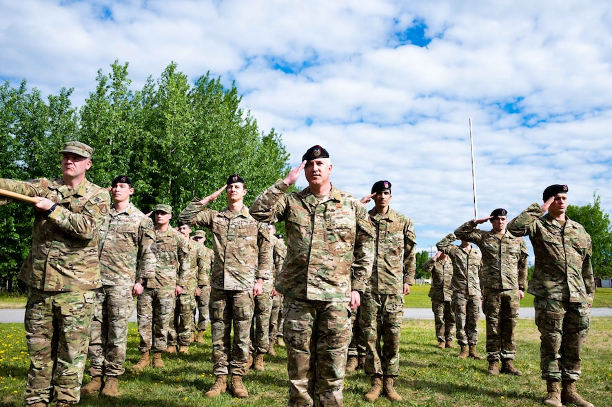 U.S. Airmen assigned to the 3rd Air Support Operations Squadron (ASOS) render the first squadron salute during a change of command ceremony at Fort Wainwright, Alaska, June 4, 2021.