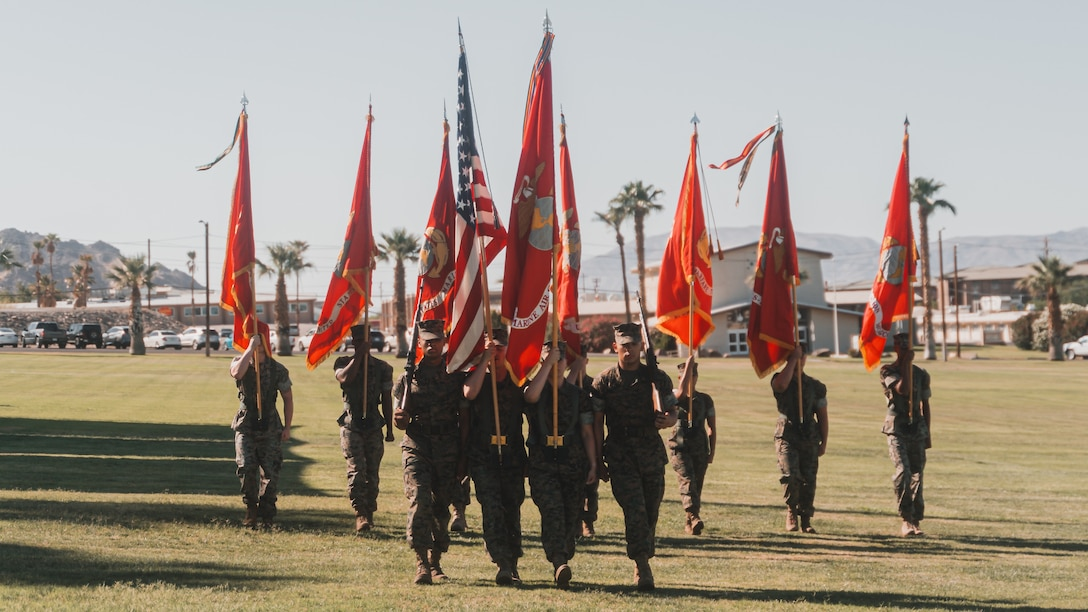 U.S. Marines retire colors during the Marine Air Ground Task Force Training Command, Marine Corps Air Ground Combat Center change of command ceremony on June 4, 2021, where Jurney relinquished command to Maj. Gen. Austin E. Renforth. (U.S. Marine Corps photo by Lance Cpl. Colton Brownlee)