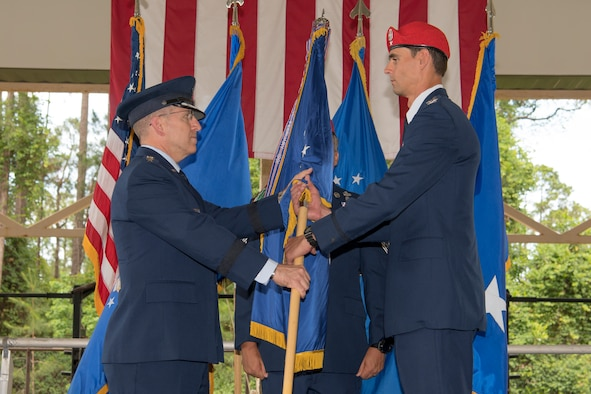 U.S. Air Force Col. Jason Daniels, right, accepts command of the 24th Special Operations Wing from U.S. Air Force Lt. Gen. Jim Slife, commander of Air Force Special Operations Command, during a change of command ceremony at Hurlburt Field, Florida, June 4, 2021.