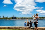Family members wave as the fast-attack submarine USS Missouri departs from Joint Base Pearl Harbor-Hickam, Hawaii, June 3, 2021, to participate in Exercise Agile Dagger 2021. A third of the Navy's Pacific submarine force got underway for the exercise, which was designed to assess warfighting readiness and build capacity for the joint force.