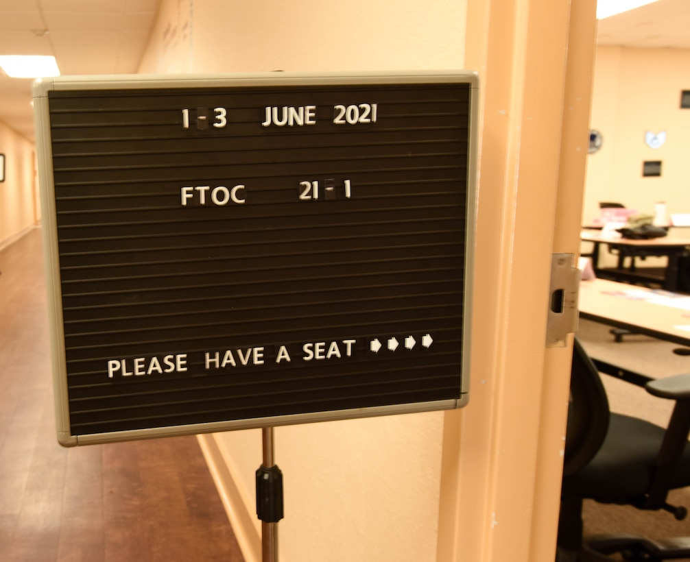 A First Term Officers Course sign is displayed in the Professional Development Center at Keesler Air Force Base, Mississippi June 1, 2021. The FTOC is the first course of its kind implemented at Keesler to further develop new company grade officers into leaders. (U.S Air Force photo by Airman 1st Class Jasmine Galloway)