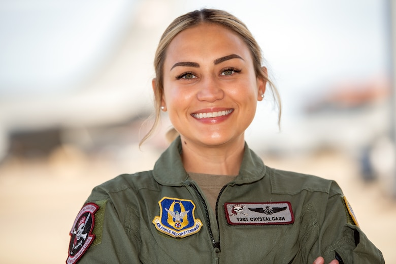 Tech Sgt. Crystal Cash, 63rd Air Refueling Squadron boom operator, pauses for a photo on the flight line, June 3, 2021, MacDill Air Force Base, Florida. Cash served at the 6th Air Refueling Wing for 6 years before transitioning to the Reserve 927th Air Refueling Wing at the same base. (U.S. Air Force photo by Staff Sgt. Bradley Tipton)