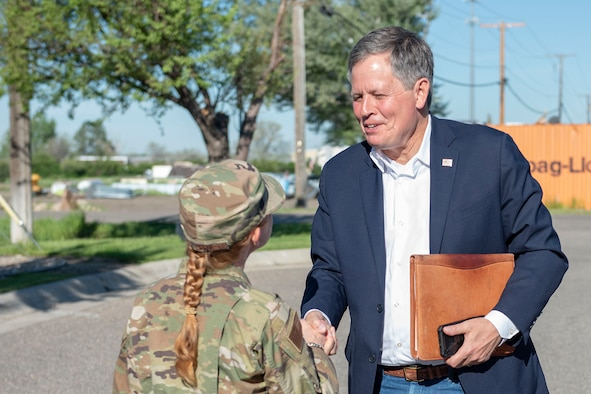 Sen. Steve Daines, right, greets Col. Anita Feugate Opperman, 341st Missile Wing commander, June 3, 2021, at his arrival to Malmstrom Air Force Base, Mont.