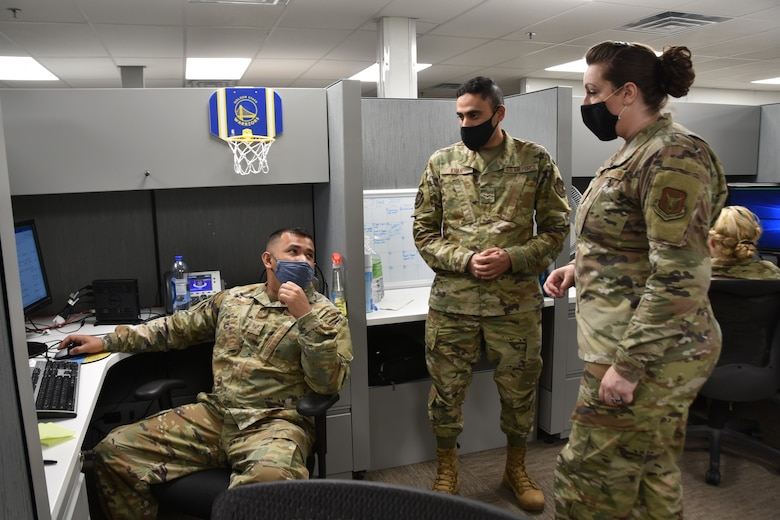 (right) 301st Fighter Wing Force Support Squadron and Wing Support Agency First Sergeant, Master Sgt. Cassandra Hernandez engages with FSS career development technicians, (left) Staff Sgt. Jose Pena and Airman First Class (center) Anwar Khan at U.S. Naval Air Station Joint Reserve Base Fort Worth, Texas on June 5th, 2021. Master Sgt. Hernandez, who has an open door policy, joined the 301 FW from the 44th Fighter Group, the wing's classic associate unit located at Eglin Air Force Base, Fla. (U.S. Air Force photo by Senior Airman William Downs)