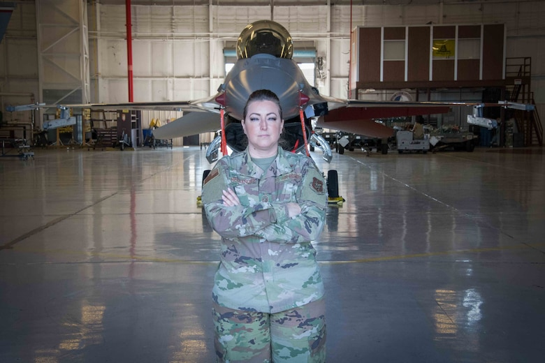 First Sergeant Cassandra Hernandez stands ready in front of a 301st Fighter wing jet at U.S. Naval Air Station Joint Reserve Base Fort Worth, Texas. Regardless of rank or duty status, the first sergeant is an accessible resource to all Airman. (U.S. Air Force photo by Senior Airman William Downs)