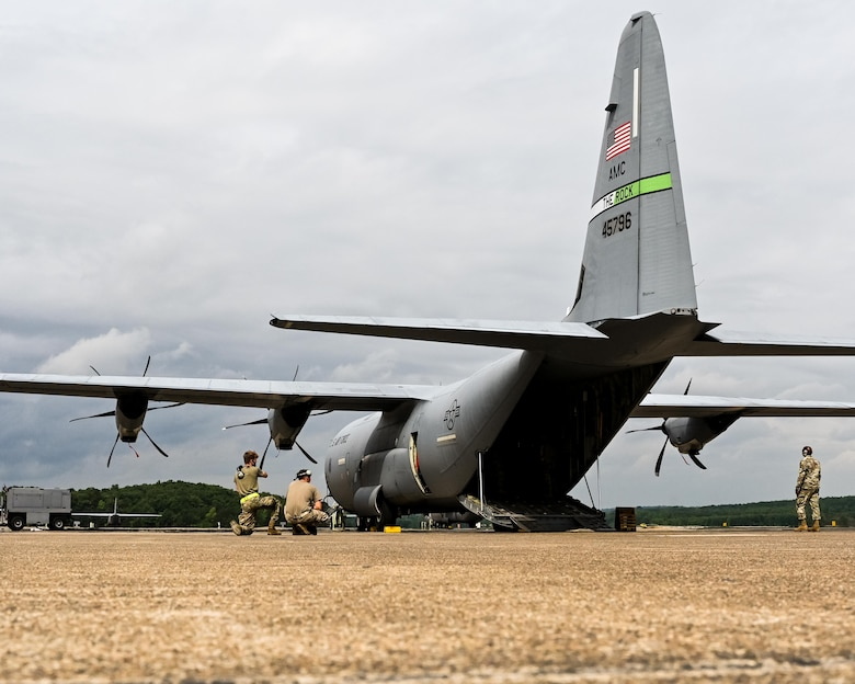 Airmen carefully load a Humvee and trailer onto a C-130J Super Hercules at Little Rock Air Force Base, Arkansas, June 5, 2021. 'Port Dawgs' from the 189th Aerial Port Flight, Air National Guard, and from the 96th Aerial Port Squadron, Air Force Reserve, created a joint training event at Little Rock Air Force Base, Arkansas, June 3-6, 2021. (U.S. Air Force photo by Maj. Ashley Walker)
