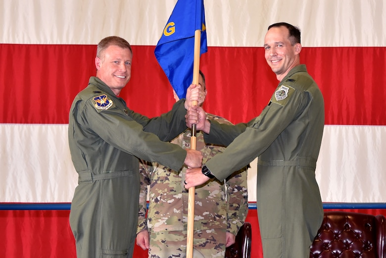 (left) Col. Allen Duckworth, 301st Fighter Wing commander, passes the guideon to Col. Benjamin Harrison, 301st Operations Group commander, June 6, 2021, at U.S. Naval Air Station Joint Reserve Base Fort Worth, Texas. The change of command ceremony is a time honored military tradition that signifies the transfer of authority from the out going commander to the new commander. (U.S. Air Force photo by Staff Sgt. Randall Moose)