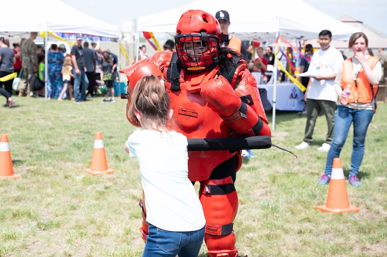 Senior Airman Jelani Arias-Pineda, right, 341st Security Forces Squadron installation patrolman, demonstrates combatives for military children during a bike safety rodeo June 4, 2021, at Malmstrom Air Force Base, Mont.