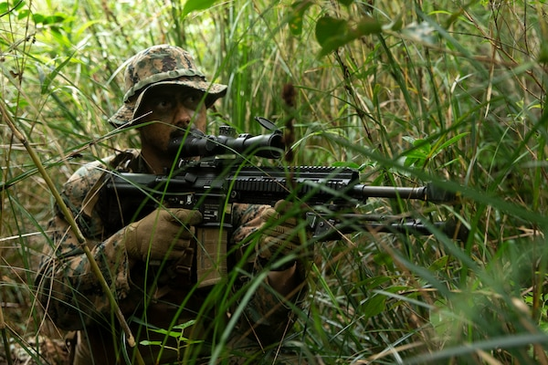A U.S. Marine prepares for an ambush during Jungle Warfare Exercise in the Northern Training Area on Okinawa, Japan, May 25.
