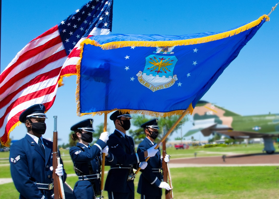 Honor guard members present the American and U.S. Air Force flag during a colors ceremony formation at Tyndall Air Force Base, Florida, April 19, 2021.