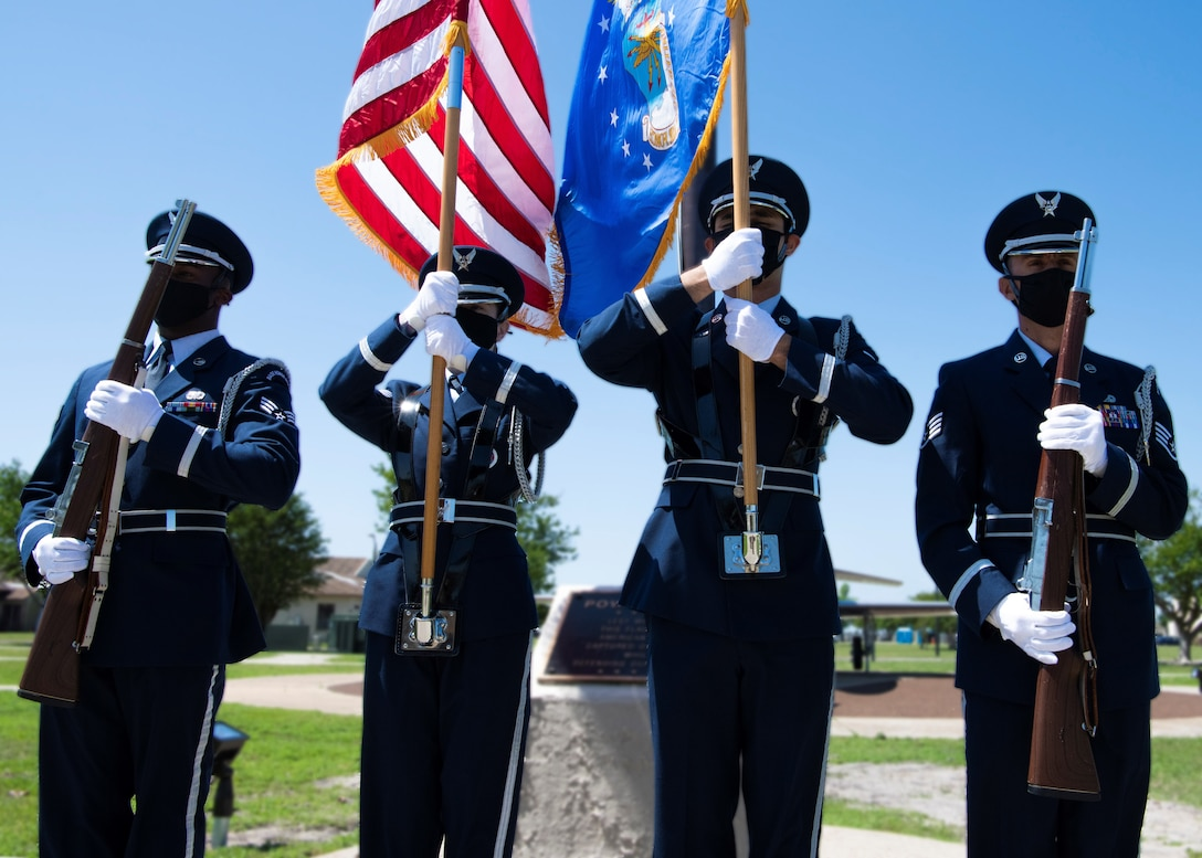 Honor guard members hold the position of port arms during a colors ceremony formation at Tyndall Air Force Base, Florida, April 19, 2021.
