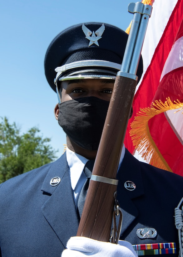 Honor guard member holds the position of port arms during a colors ceremony formation at Tyndall Air Force Base, Florida, April 19, 2021.