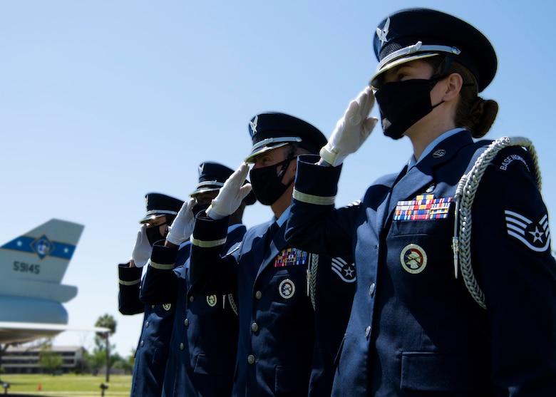 Honor guard members render a salute at Tyndall Air Force Base, Florida, April 19, 2021.