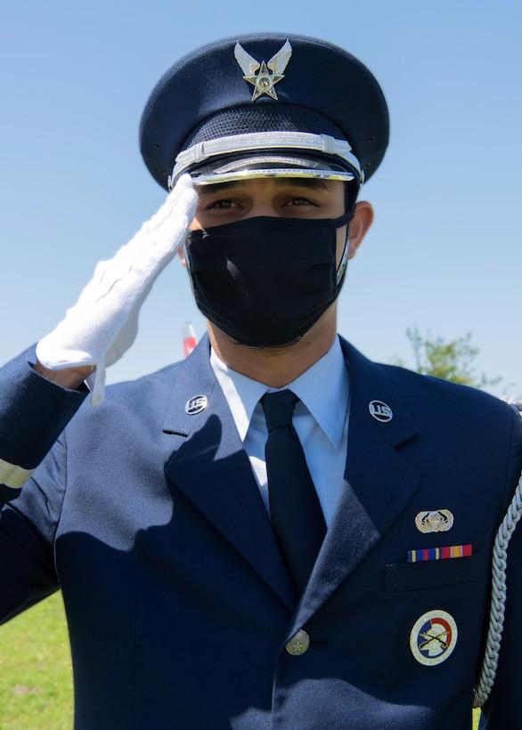 Honor guard member renders a salute at Tyndall Air Force Base, Florida, April 19, 2021.