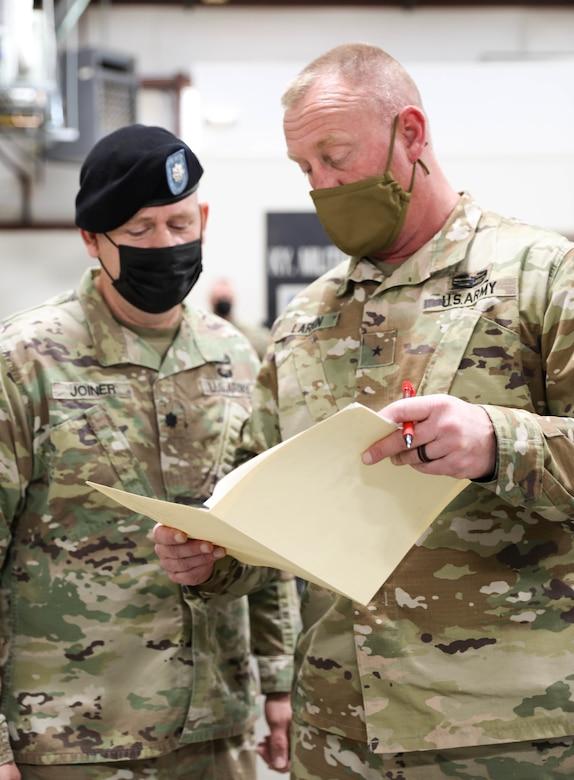 Lt. Col. Allen Joiner and Brig. Gen. Robert J. Larkin, Deputy Adjutant General, Kentucky National Guard review statements