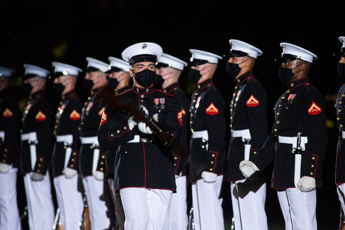 Corporal Xavier Cockrell, number one rifle inspector, Silent Drill Platoon, conducts a rifle inspection during the Friday Evening Parade at Marine Barracks Washington, June 4, 2021