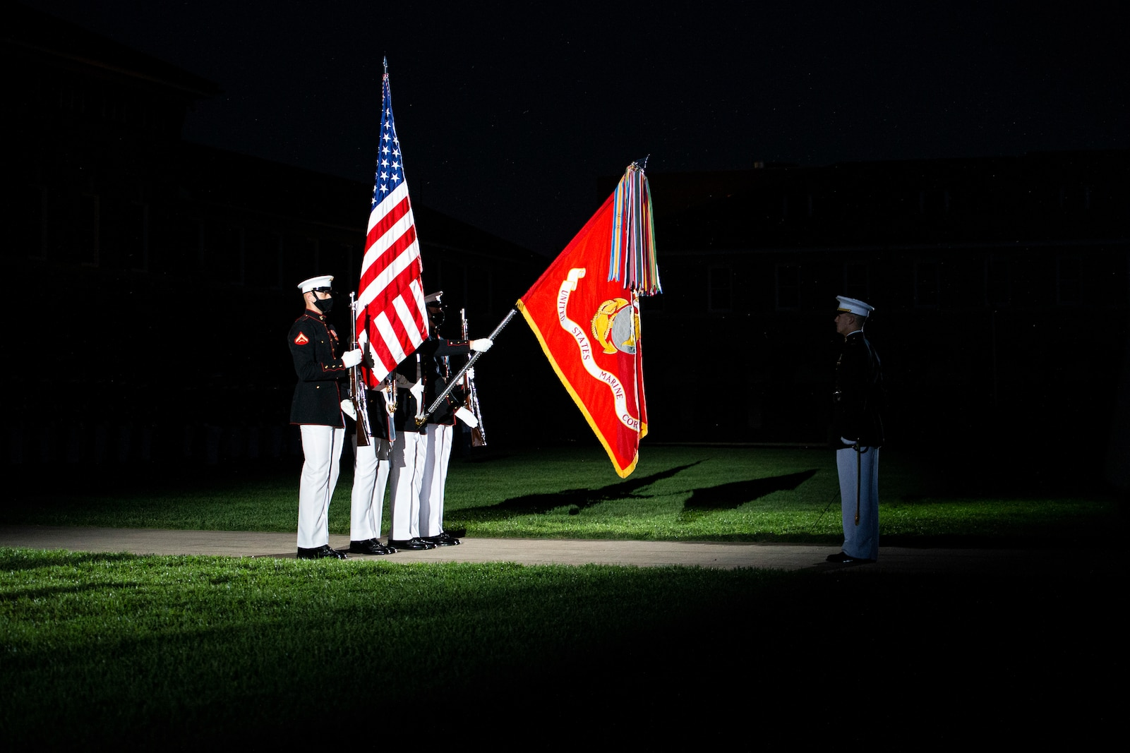 Marines with the Official U.S. Marine Corps Color Guard present the colors during the Friday Evening Parade at Marine Barracks Washington, June 4, 2021.