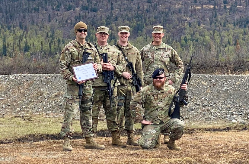 Alaska Air National Guard Staff Sgt. Matthew Larson, a security forces member with the 268th Security Forces Squadron, and his team pose for a photo after the annual Adjutant General Match, May 16, 2021. Larson took first place in the open rifle marksmanship competition, was added to the state team to compete in the regional competition, and was awarded the Governor's Twenty tab, which is generally awarded to the top 20 marksmen in the state. (Courtesy photo)