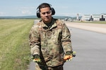 U.S. Air Force Master Sgt. Jose Marrero, noncommissioned officer in charge of airfield management with the 167th Operations Support Group, displays a pyrotechnical device with cartridges used as part of the Bird/wildlife Aircraft Strike Hazards (BASH) program, at the 167th Airlift Wing, Martinsburg, West Virginia, May 12, 2021. The airfield management team uses many noise-making devices to encourage animals to move away from the airfield.