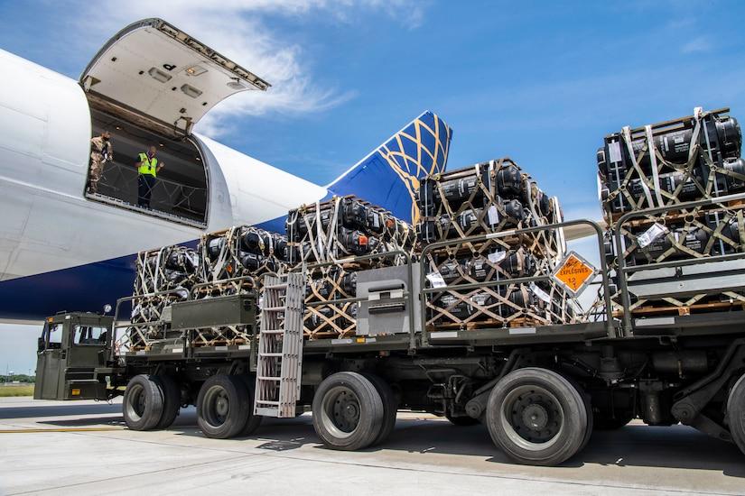Airmen load cargo onto a plane.