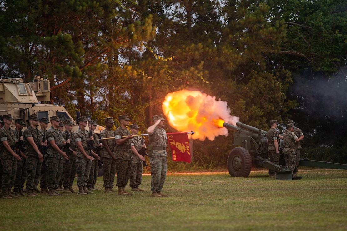 U.S. Marines with 10th Marine Regiment, 2d Marine Division, perform a 21-gun salute during a change of command ceremony on Camp Lejeune, N.C., June 3, 2021. The ceremony represents the transfer of authority, responsibility, and accountability from the out-going officer to the incoming commanding officer. (U.S. Marine Corps photo by Lance Cpl. Brian Bolin Jr.)