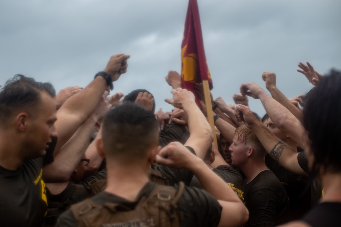 U.S. Marines with Fox Company, 2d Battalion, 6th Marine Regiment (2/6), 2d Marine Division, celebrate after a memorial workout on Camp Lejeune, N.C., June 4, 2021. Several members across the community and across the Marine Corps attended the event, honoring Cpl. Albert Gettings, a 2/6 Marine who was killed by enemy fire during Operation Iraqi Freedom in 2006. The event exemplified Gettings' characteristics of unwavering dedication, esprit de corps, and steadfast discipline. (U.S. Marine Corps photo by Lance Cpl. Jacqueline Parsons)