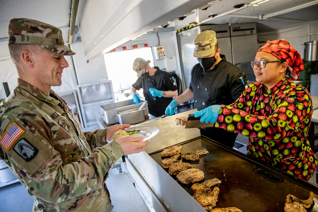 Representatives from local businesses participate in the Alaska Army National Guard's Culinary Showcase, an event celebrating the launch of the new Partnership for Youth Success (PaYS) program on Joint Base Elmendorf-Richardson, May 14. The PaYS program is a strategic partnership between the Army National Guard and a cross section of private businesses, universities, and public institutions. It provides Alaska's newest Citizen-Soldiers the opportunity to increase their prospects for potential civilian employment while serving their country. (U.S. Army National Guard photo by Edward Eagerton)
