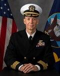 A headshot of a Navy commander