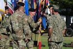 U.S. Army Command Sgt. Maj. Scott A. Brzak, right, the U.S. Army Pacific command sergeant major, passes the unit's colors to Gen. Paul J. LaCamera, outgoing USARPAC commander during the change of command ceremony June 4, 2021 at Fort Shafter, Hawaii. The ceremony was hosted by U.S. Navy Adm. John C. Aquilino, U.S. Indo-Pacific commander.
