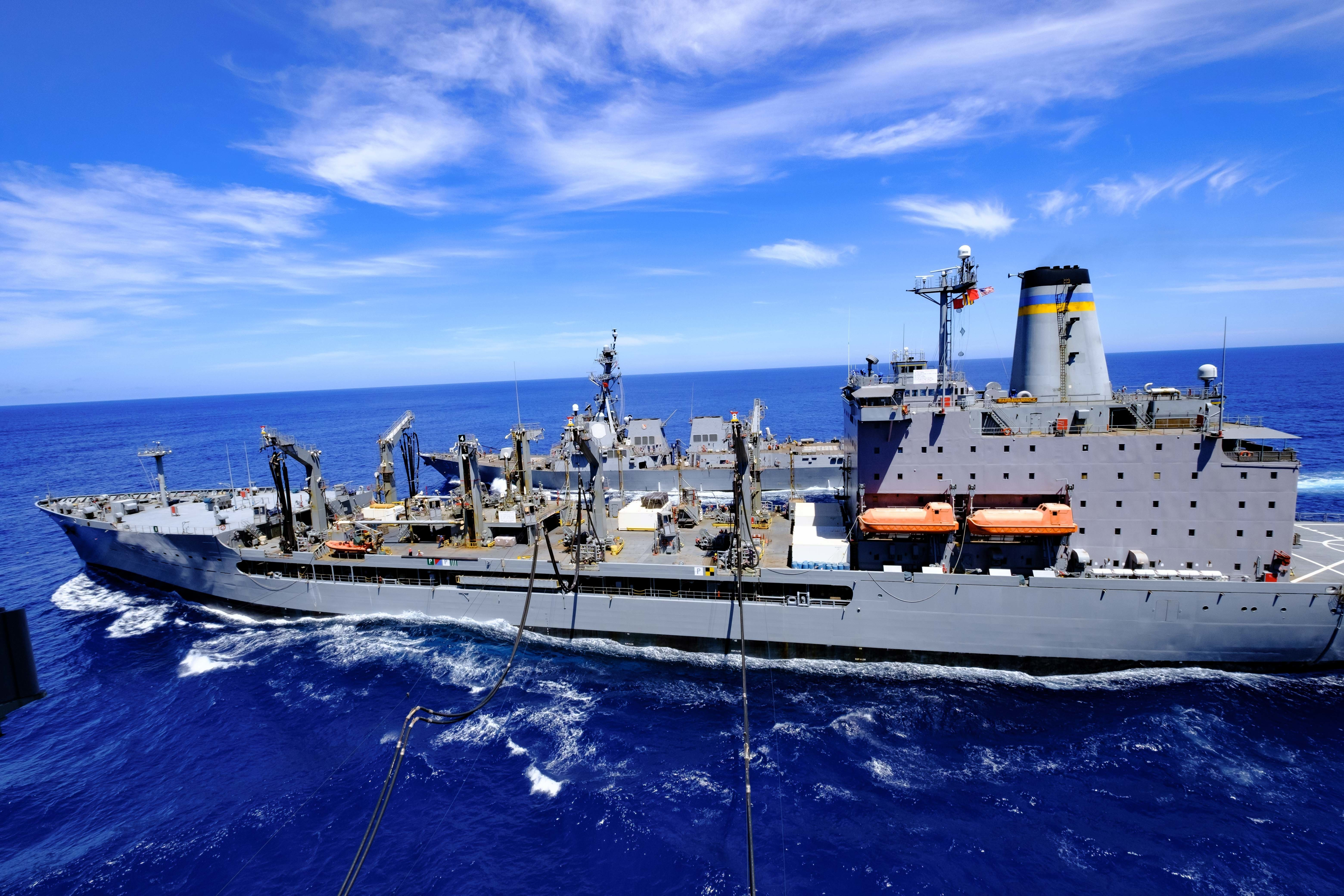 The aircraft carrier USS Ronald Reagan (CVN 76) and the Arleigh Burke-class guided-missile destroyer USS Halsey (DDG 97) conducts a simultaneous replenishment-at-sea with the Henry J. Kaiser-class underway replenishment oiler USNS Rappahannock (T-AO-204).