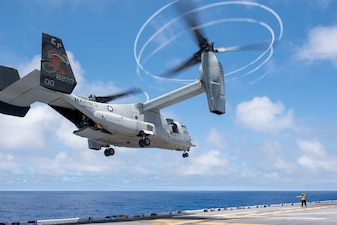 An MV-22B Osprey takes off from USS America (LHA 6).