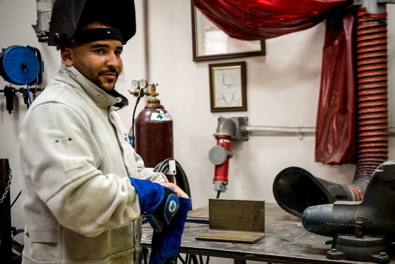 U.S. Air Force Senior Airman Doniel Dortch, 906th Aerial Refueling Squadron metals technology fabrication welder, welds a piece of metal together for an engine trainer on Scott Air Force Base, Illinois. The metal piece was a small piece that would be put onto an engine specially made for simulating real engines for training purposes.  (U.S. Air Force photo by Airman 1st Class Mark Sulaica)